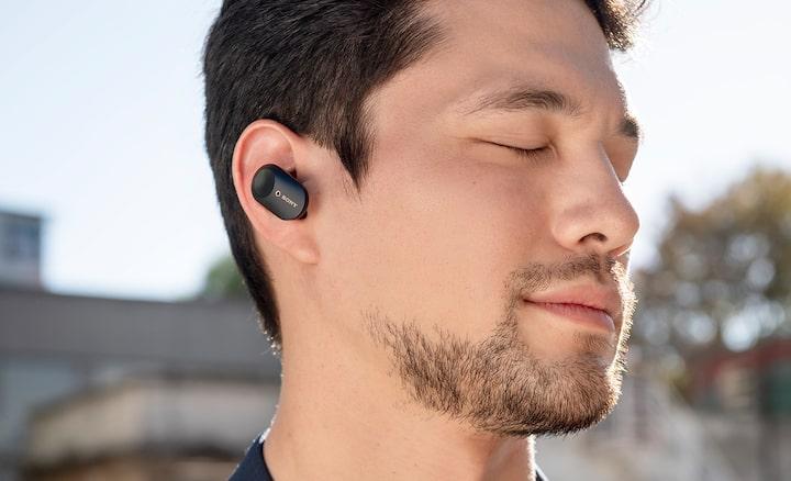 Lifestyle shot of man wearing truly wireless WF-1000XM3 headphones.