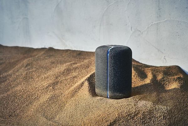 SRS-XB402G wireless speaker on a sandy surface