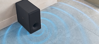 High angled shot of SA-SW3 speaker on marble floor tiles with sound waves emanating from the speaker.