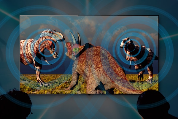 Image of dinosaurs on big-screen TV illustrating how sound follows the action.